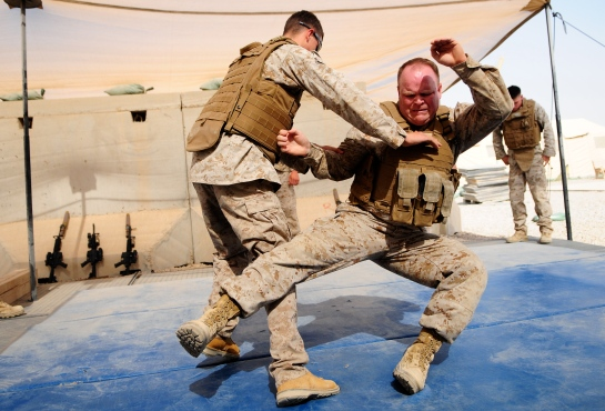 Martial arts videos. One soldier uses a martial arts throw on another